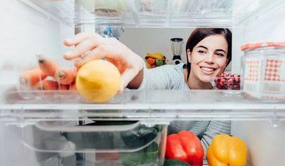 smiling-woman-looking-inside-fridge